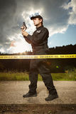 Police man in uniform on place of investigation Stock Photography