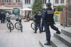 Police man and police women in bicycle observing in main place stock image
