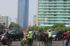 Police manage traffic jam in Jakarta. The police manage traffic flow past the Hotel Indonesia roundabout, July 12, 2012 Royalty Free Stock Photo
