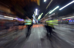 Police Mardi Gras. Blurred image of policemen walking street of New Orleans during Mardi Gras parade