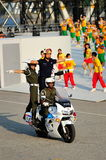 Police militaire exécutant des cascades pendant le NDP 2012 Photo libre de droits