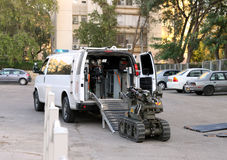 The police or military robot for working with bomb. BEER SHEVA, ISRAEL - NOVEMBER 18, 2012:  The police or military robot for working with bomb enters a vehicle Stock Photography
