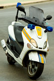 Police Motor Cycle. A Spanish Police Motorcycle left unattended with lights flashing on a side street Stock Photos