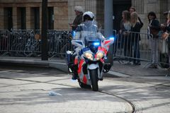 Police motor driving on Noordeinde on the Prince day Parade in The Hague Stock Photo