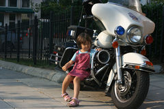 Police motorbike. Child sits on police motorbike Stock Images