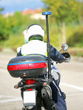 Police motorbike with blue siren. On the road stock image