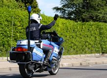 Police motorbike patrolman with high hand Stock Images