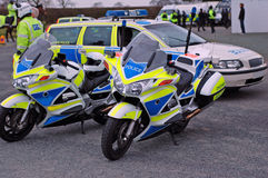 Police Motorbikes. Police motorcycles and police car at the scene of a public disturbance Stock Photos