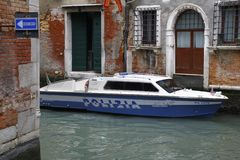 Venice, Italy - Police motorboat at work. Police motorboat at work. A canal of venezia with police boat royalty free stock photography