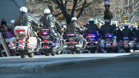 Police motorcade during a fall parade stock footage