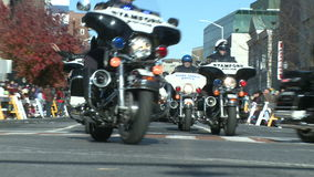 Police motorcade during a fall parade (3 of 8) stock video