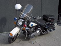 Police Motorcycle. A fancy police motorcycle sits parked on the sidewalk Stock Photos