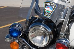 Police motorcycle. Closeup of the front of a police motorcycle, with red and blue lights and a police sticker on the windshield Royalty Free Stock Photos