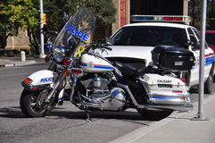 Police motorcycle and cruiser Stock Photos