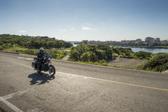 Police motorcycle driving Havana Royalty Free Stock Photography