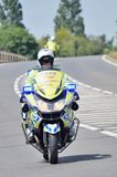 Police motorcycle escort on road Stock Images