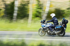 Police on a motorcycle Stock Photography