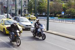 Police on a motorcycle paroling royalty free stock images