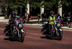 Police Motorcyclists. Two Police Motorcyclists patrol downtown Royalty Free Stock Image