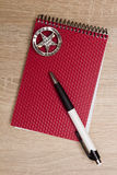 Police notebook. With pen and Texas Ranger badge Royalty Free Stock Photography