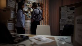 Police office colleagues working together on crime investigation in office. Stock photo royalty free stock image