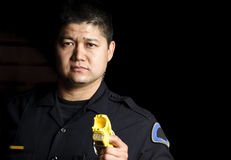 Police officer. A male police officer pointing his taser gun at night Stock Image