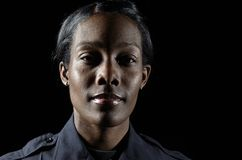 Police officer. A female police officer in the night during her shift Stock Images