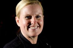 Police Officer. A smiling female police officer in the night during her shift Stock Photography