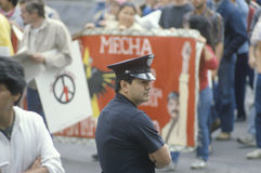 Police officer. Observing peace rally, Los Angeles, California Stock Photos