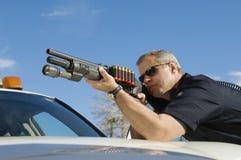 Police Officer Aiming Shotgun. Caucasian male police officer aiming shotgun Royalty Free Stock Photos
