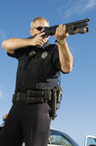 Police Officer Aiming Weapon Stock Photography