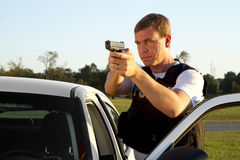 Police Officer Aims a Gun Royalty Free Stock Images