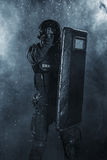 Police officer with ballistic shield Royalty Free Stock Photography