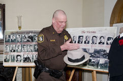 Police officer displays items from st valentines day massacre. A police officer from Berrien county Michigan, works on a display about the st valentines day royalty free stock photos