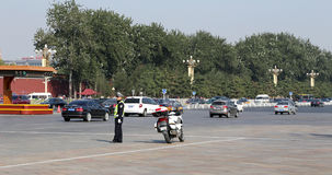 Police officer with bike on the road in central Beijing Royalty Free Stock Photos