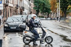 Police officer blocking street during protest. Strasbourg, France - Sep 12, 2017: Young caucasian French police officer blocking street on a rainy day during royalty free stock photo