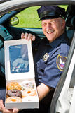 Police Officer - Box of Donuts stock image