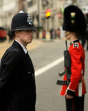 Police Officer and British Army Soldier at Thatcher funeral Royalty Free Stock Photography