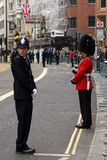 Police Officer and British Army Soldier at Thatcher funeral. A sergeant from the Guards and a PC in the Metropolitan Police line the route of Thatcher's funeral Stock Photos