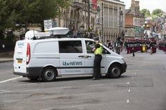 Police officer checking white van Stock Images