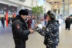 A police officer checks the national database informacionnoi at the entrance to Paveletskaya station. Royalty Free Stock Photography