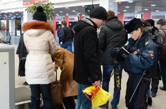A police officer checks the national database informacionnoi at the entrance to Paveletskaya station. Stock Photography
