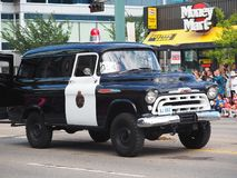 Police Officer With Classic Paddy Wagon In KDays Parade Royalty Free Stock Image