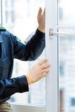 Police officer at crime scene after burglary. Police officer takes evidence on window after burglary Royalty Free Stock Photography