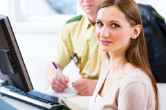 Police officer in department registering complaint Stock Photos
