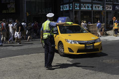 Police Officer Directs Midtown Traffic. New York, NY USA --Aug 3, 2016-- A police officer directs traffic in Midtown Manhattan. Editorial Use Only Royalty Free Stock Images