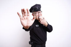 Police officer with donut Royalty Free Stock Images
