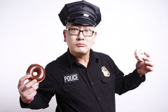 Police officer with donuts Stock Images