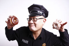 Police officer with donuts Stock Photography
