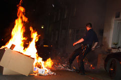 Police officer fighting Street fire Royalty Free Stock Photo